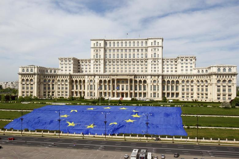A large European Union flag is displayed in front of Romania's Parliament Building to mark EU Day in Bucharest May 9, 2013. REUTERS/Bogdan Cristel