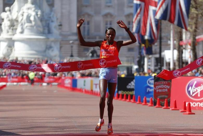 Priscah Jeptoo of Kenya wins the women's Elite London Marathon in central London, April 21, 2013. REUTERS/Andrew Winning
