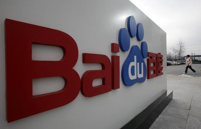 A woman walks past the company logo of Baidu at its headquarters in Beijing February 10, 2010. REUTERS/Jason Lee