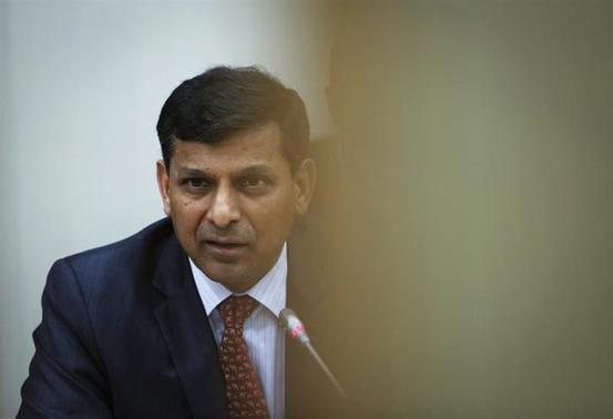 Reserve Bank of India (RBI) Governor Raghuram Rajan speaks during a news conference after the mid-quarter monetary policy review at the RBI headquarters in Mumbai December 18, 2013. REUTERS/Danish Siddiqui