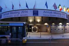 A bus drives past the entrance of the congress centre for the annual meeting of the World Economic Forum (WEF) 2014 in the early morning in Davos January 21, 2014. REUTERS/Ruben Sprich