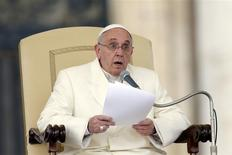 Pope Francis reacts as he conducts his weekly general audience at St. Peter's Square at the Vatican January 22, 2014. REUTERS/Giampiero Sposito