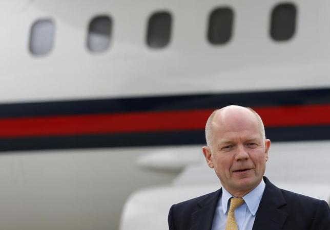British Foreign Secretary William Hague arrives at Geneva International airport in Geneva November 23, 2013. REUTERS/Denis Balibouse