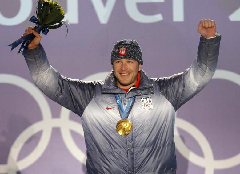 Gold medallist Bode Miller of the U.S. celebrates during the medals ceremony for the men's super combined alpine skiing event during the Vancouver 2010 Winter Olympics at Whistler, British Columbia February 21, 2010. REUTERS/Mike Segar