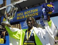 Wesley Korir of Kenya poses for photographers after winning the men's division of the 116th Boston Marathon in Boston, Massachusetts April 16, 2012. REUTERS/Brian Snyder
