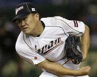 Japan's pitcher Masahiro Tanaka pitches against the Netherlands in the fifth inning at the World Baseball Classic (WBC) second round game in Tokyo March 12, 2013. REUTERS/Toru Hanai