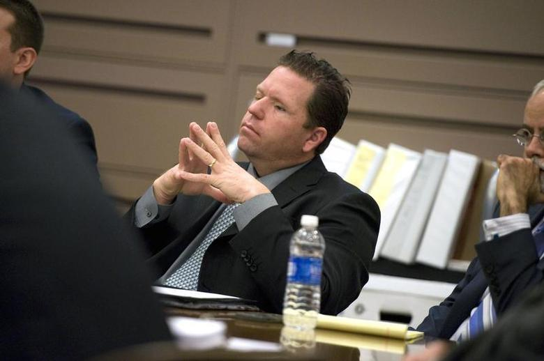 Former Fullerton police officer Jay Cicinelli listens to closing arguments in the second degree murder case against him and fellow former officer Manuel Ramos in Santa Ana, California January 9, 2014. REUTERS/Joshua Sudock/Pool