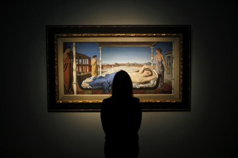 A worker poses with Paul Delvaux's ''La Venus endormie'' at Christie's auction house in London January 13, 2014. REUTERS/Andrew Winning