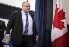 Toronto Mayor Rob Ford arrives to make a statement about his personal life and the Capital and Operating Budgets meeting that had just finished at City Hall in Toronto, January 22, 2014. REUTERS/Mark Blinch