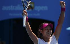 Li Na of China celebrates defeating Eugenie Bouchard of Canada in their women's singles semi-final match at the Australian Open 2014 tennis tournament in Melbourne January 23, 2014. REUTERS/Petar Kujundzic