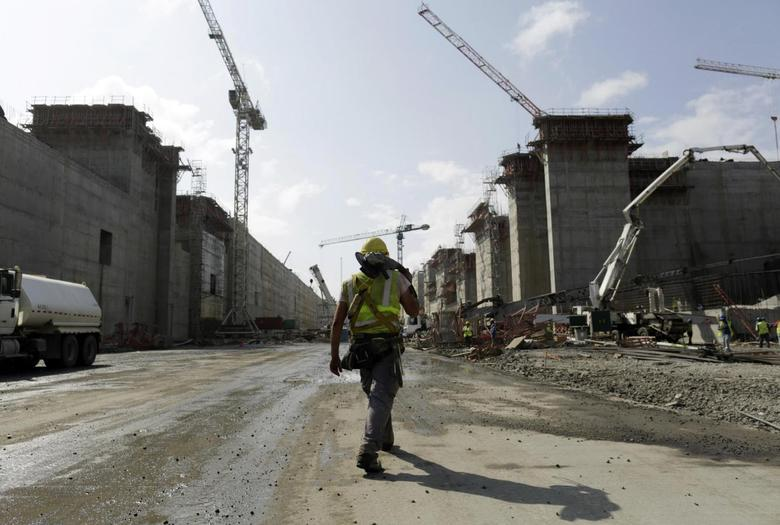 A worker walks at the construction site of the Panama Canal Expansion project on the Atlantic side on the outskirts of Colon City January 15, 2014. REUTERS/Carlos Jasso