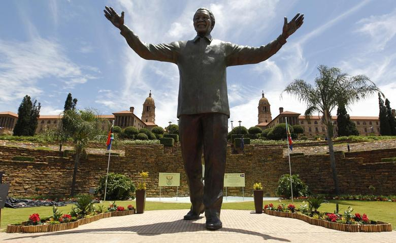 A 9-metre (30-feet) bronze statue of the late former South African President Nelson Mandela is unveiled as part of the Day of Reconciliation Celebrations at the Union Buildings in Pretoria December 16, 2013. REUTERS/Thomas Mukoya
