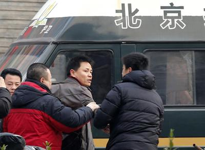China tries three anti-graft activists in two days