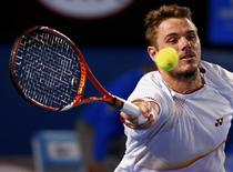 Stanislas Wawrinka of Switzerland hits a return to Tomas Berdych of the Czech Republic during their men's singles semi-final match at the Australian Open 2014 tennis tournament in Melbourne January 23, 2014. REUTERS/Petar Kujundzic