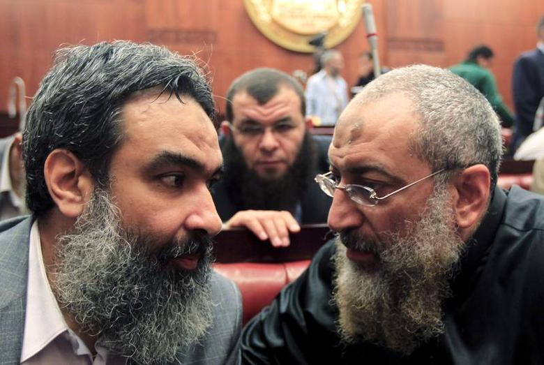Salafist cleric leader Yasser Borhamy (R) speaks with Bassam al-Zarqa, one of the advisors to former Egypt's President Mohamed Mursi, at the Shura Council during the final vote on a draft new Egyptian constitution, November 29, 2012. REUTERS/Mohamed Abd El Ghany