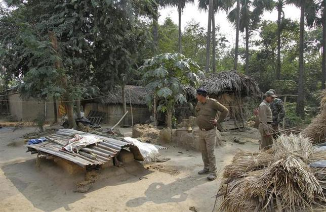 Police personnel inspect the area where a woman was gang-raped at Birbhum district in West Bengal January 23, 2014. REUTERS/Stringer