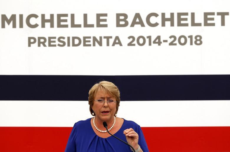 Chile's President-elect Michelle Bachelet answers a question during a news conference at her headquarters in Santiago, December 16, 2013. REUTERS/Ivan Alvarado