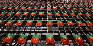 Le Portugal a atteint l'objectif de déficit budgétaire fixé pour 2013 par ses bailleurs de fonds internationaux, en le limitant à environ 5% du produit intérieur brut (PIB), annonce le ministère des Finances. /Photo d'archives/REUTERS/Nacho Doce