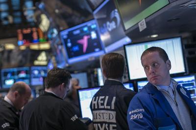 Wall Street falls as China data trigger selloff in...