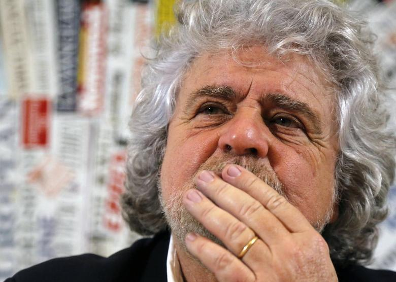 The 5-Star Movement leader and comedian Beppe Grillo looks on before a news conference for foreign press in downtown Rome January 23, 2014. REUTERS/Stefano Rellandini