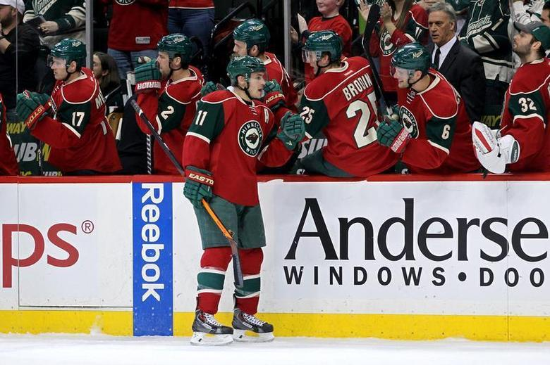 Dec 17, 2013; Saint Paul, MN, USA; Minnesota Wild forward Zach Parise (11) celebrates his goal with teammates during the first period against the Vancouver Canucks at Xcel Energy Center. Brace Hemmelgarn-USA TODAY Sports
