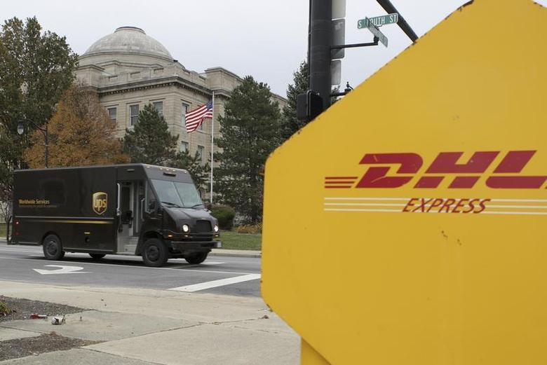 A UPS truck drives in front of the Clinton County Courthouse past a DHL drop box in Wilmington, Ohio, November 11, 2008.