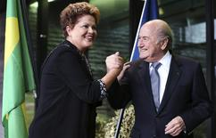 Brazil's President Dilma Rousseff (L) greets FIFA President Sepp Blatter during a visit at the FIFA headquarters in Zurich January 23, 2014. REUTERS/Thomas Hodel