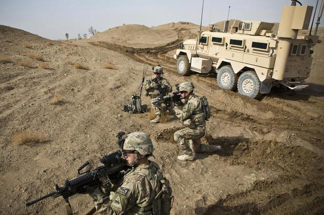 U.S. Army soldiers with Charlie Company, 36th Infantry Regiment, 1st Armored Division set up a supportive position during a mission near Command Outpost Pa'in Kalay in Maiwand District, Kandahar Province February 3, 2013. REUTERS/Andrew Burton