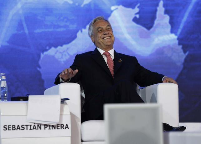 Chile's President Sebastian Pinera reacts during a dialogue session at the Asia-Pacific Economic Cooperation (APEC) CEO Summit in Nusa Dua, Indonesia resort island of Bali October 6, 2013. REUTERS/Beawiharta