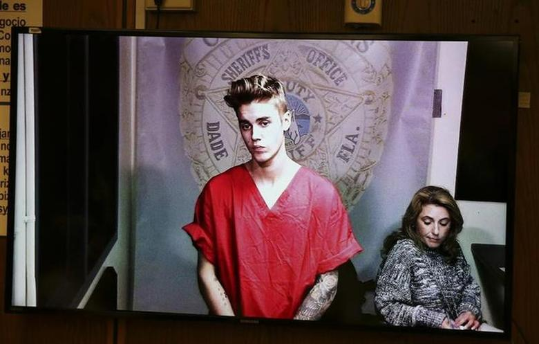 Pop singer Justin Bieber appears via video conference in his first court appearance since being arrested early morning in Miami, Florida January 23, 2014. REUTERS/Walter Michot/Pool