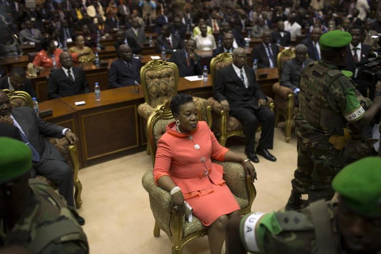 New parliamentary-elected interim President of the Central African Republic Catherine Samba-Panza sits surrounded by African Union (AU) peacekeeping soldiers prior to her swearing-in ceremony at the National Assembly in the capital Bangui January 23, 2014. REUTERS/Siegfried Modola