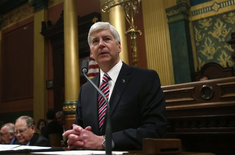 Michigan's Governor Rick Snyder gives his annual State of the State address to the Assembly at the State Capitol in Lansing, Michigan January 16, 2014. REUTERS/Rebecca Cook