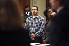 Eric Rivera, Jr. stands as the jury enters the courtroom during closing arguments of the Sean Taylor murder trial in Miami, Florida October 30, 2013. REUTERS/Emily Michot/Pool