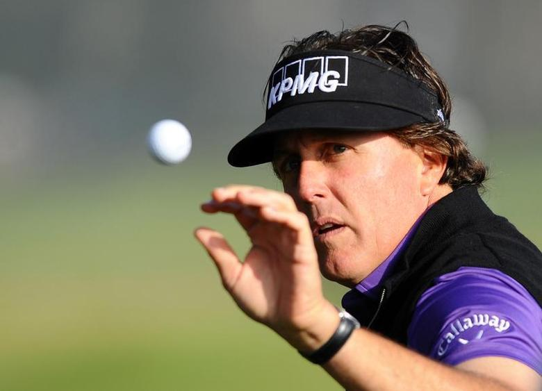 Jan 23, 2014; La Jolla, CA, USA; Phil Mickelson warms up on the driving range prior to the first round of the Farmers Inurance Open golf tournament at Torrey Pines Municipal Golf Course. Mandatory Credit: Christopher Hanewinckel-USA TODAY Sports