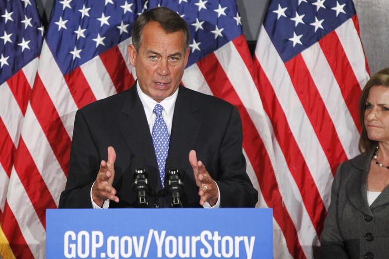 U.S. House Speaker John Boehner (R-OH) speaks next to Representative Lynn Jenkins (R-KS) (R) during a news conference at the Republican National Committee offices on Capitol Hill in Washington October 23, 2013. REUTERS/Jonathan Ernst