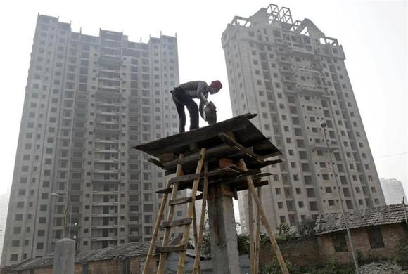 A labourer works at the construction site of a residential complex in Kolkata December 21, 2013. REUTERS/Rupak De Chowdhuri/Files
