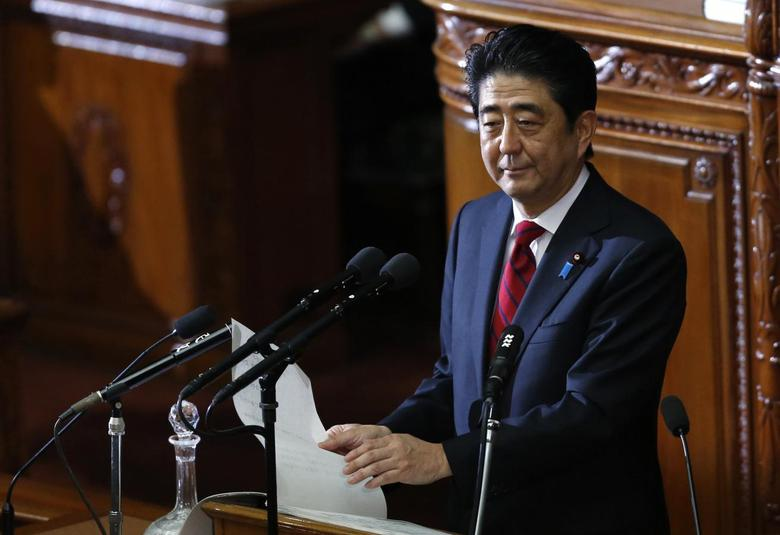 Japan's Prime Minister Shinzo Abe makes a policy speech during the start of an ordinary session at the lower house of the parliament in Tokyo January 24, 2014. REUTERS/Yuya Shino