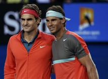 Roger Federer (L) of Switzerland poses for a photo with Rafael Nadal of Spain before their men's singles semi-final match at the Australian Open 2014 tennis tournament in Melbourne January 24, 2014. REUTERS/Jason Reed