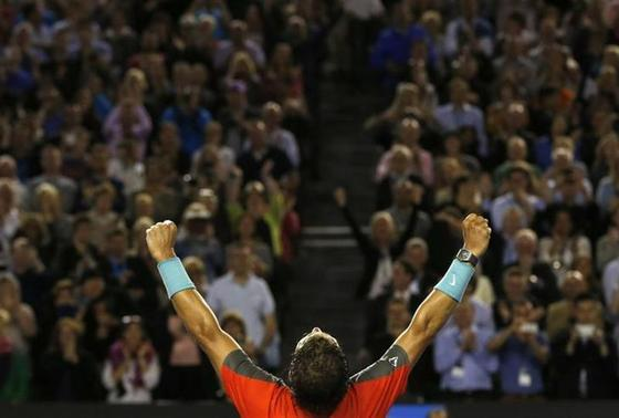 Rafael Nadal of Spain celebrates defeating Roger Federer of Switzerland in their men's singles semi-final match at the Australian Open 2014 tennis tournament in Melbourne January 24, 2014. REUTERS/Bobby Yip