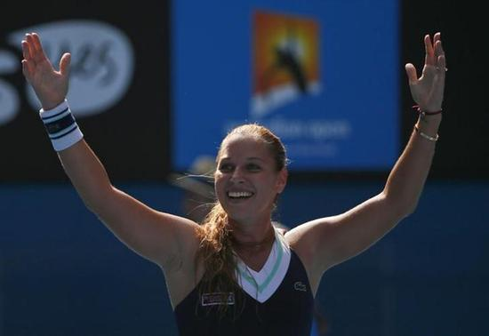 Dominika Cibulkova of Slovakia celebrates defeating Agnieszka Radwanska of Poland in their women's singles semi-final match at the Australian Open 2014 tennis tournament in Melbourne January 23, 2014. REUTERS/Petar Kujundzic