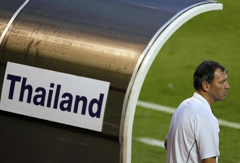 Bryan Robson, head coach Thailand's national team, watches their friendly match against Leicester City in Bangkok October 9, 2010. REUTERS/Damir Sagolj