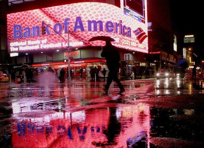 A man walks near a Bank of America branch in New York's Times Square Decemeber 11, 2008. REUTERS/Brendan McDermid