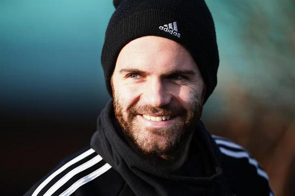 Chelsea's Juan Mata walks to a training session at the team training facility in Stoke D'Abernon to the south of London, December 10, 2013. REUTERS/Andrew Winning/Files