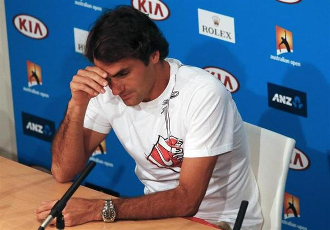 Roger Federer of Switzerland reacts during a news conference after his men's singles semi-final match against Rafael Nadal of Spain at the Australian Open 2014 tennis tournament in Melbourne January 24, 2014. REUTERS/David Gray