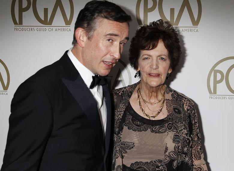 Actor Steve Coogan from the film'' Philomena'', an Oscar Best Picture nominee, arrives with Philomena Lee, whose life was featured in the film, at the 25th Annual Producers Guild of America Awards in Beverly Hills, California January 19, 2014. REUTERS/Fred Prouser