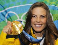 Gold medallist Torah Bright of Australia, poses with her medal during the medal ceremony for the women's halfpipe at the Vancouver 2010 Winter Olympics, in this file photo from February 19, 2010. REUTERS/Todd Korol/Files