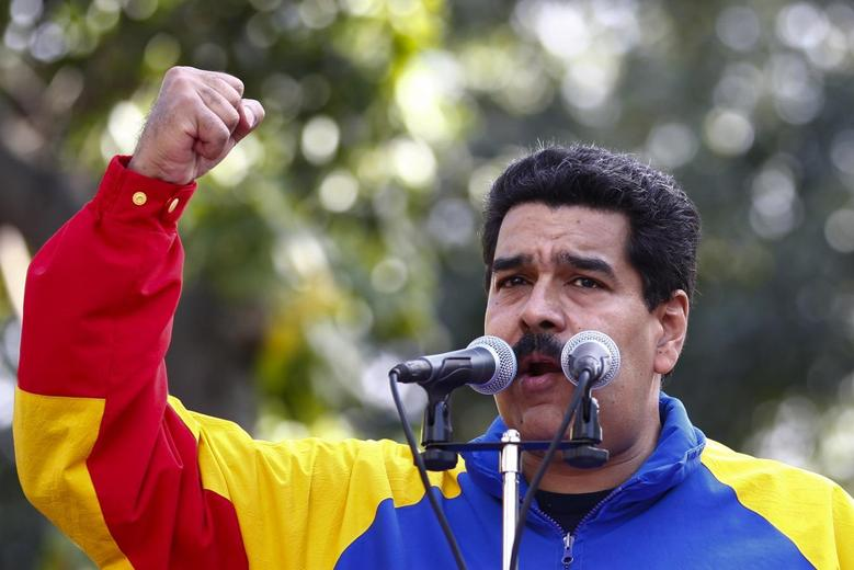 Venezuelan President Nicolas Maduro talks to supporters during a ceremony to commemorate the 56th anniversary of the end of Venezuelan dictator Marcos Perez Jimenez's regime in Caracas January 23, 2014. REUTERS/Carlos Garcia Rawlins