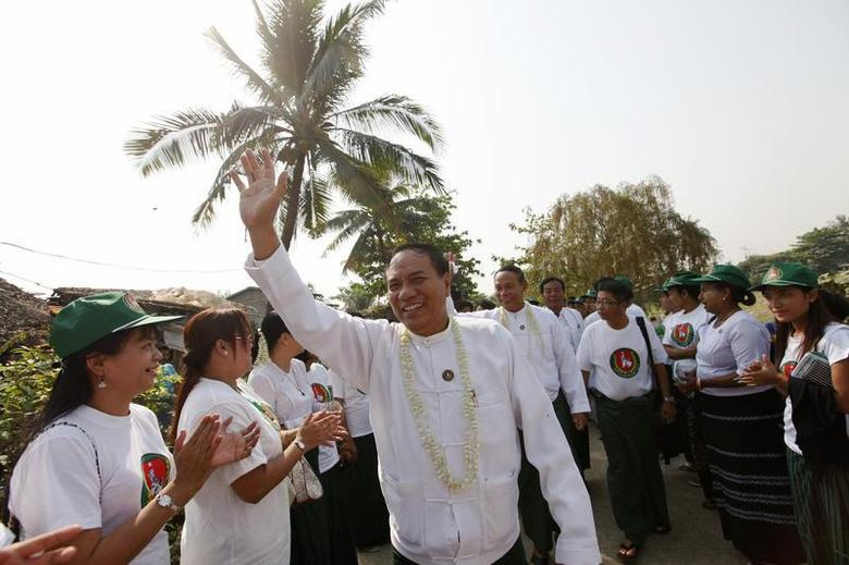 Ye Htut (C), candidate from the Union Solidarity and Development Party (USDP), waves his hand during his election campaign at Mayangon township in Yangon March 7, 2012. REUTERS/Soe Zeya Tun