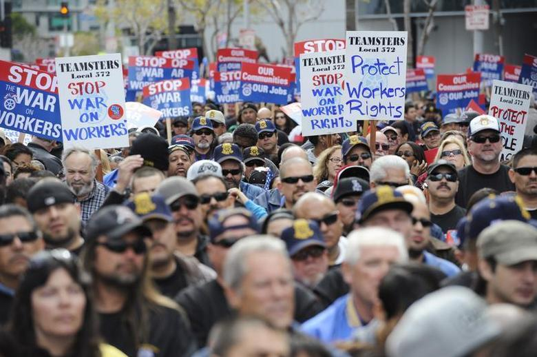 Thousands gather for a march and rally by labor union supporters in Los Angeles March 26, 2011. REUTERS/Phil McCarten
