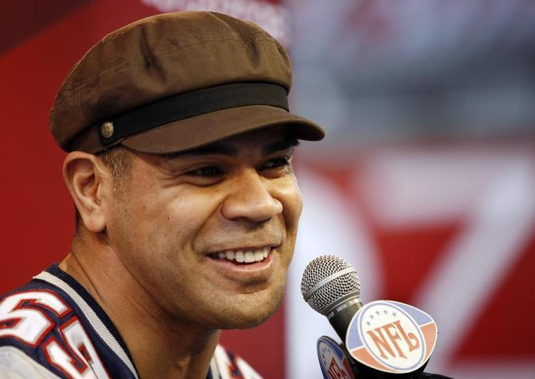 New England Patriots' Junior Seau answers questions during media day for the National Football League's (NFL) Super Bowl XLII in Glendale, Arizona January 29, 2008. REUTERS/Jeff Topping